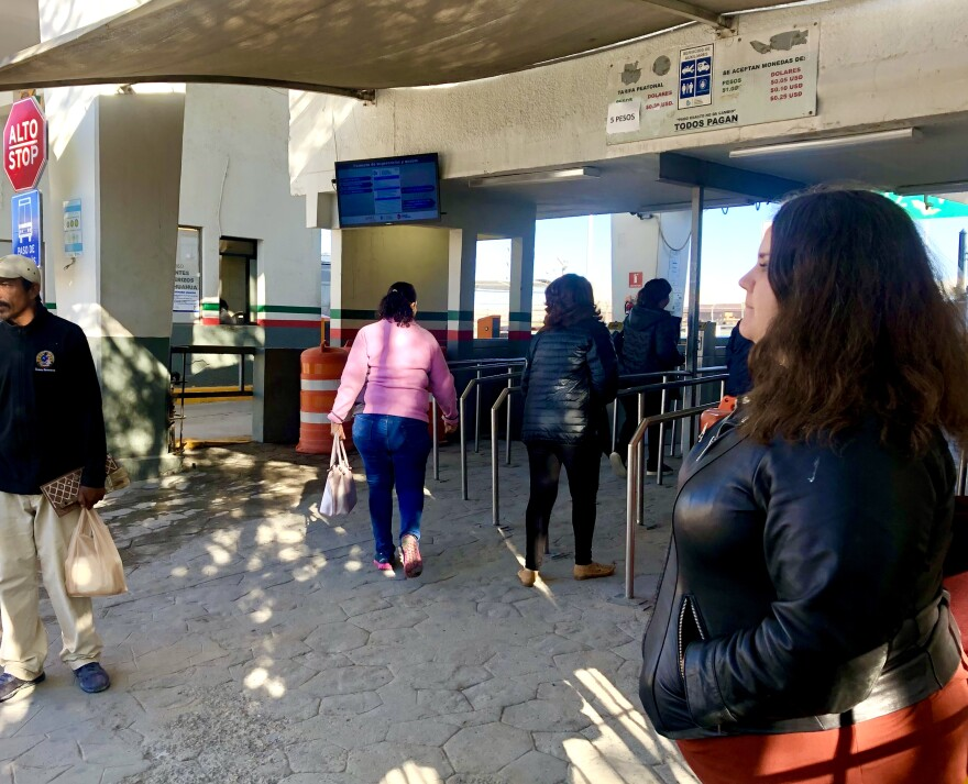 Immigration attorney Taylor Levy stands near a port of entry in Ciudad Juárez, where she offers legal advice to asylum seekers on their way to U.S. immigration court.