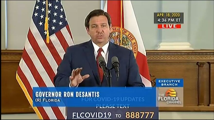Gov. ron DeSantis in front of a podium