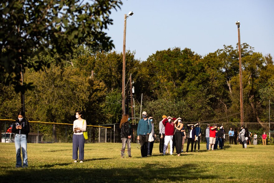 Lines for voting on day one of early voting for the 2020 elections at the South Austin Recreation Center.