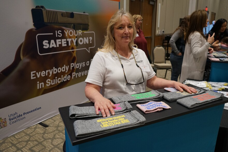 Northeastern Counseling Center prevention specialist Robin Hatch gave out gun socks screen-printed with the National Suicide Prevention Lifeline information at the Vernal Gun & Knife Show in Vernal, Utah.