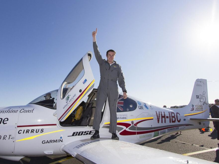 Lachlan Smart, 18, steps out of his plane on Saturday morning.