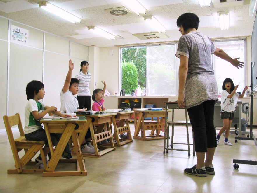 Four first-grade students study at the Tomioka Town Joint  Temporary School. The school, housed into a  soon-to-be-abandoned auto parts factory, is home to refugee pupils from  Fukushima  prefecture's radiation zone.