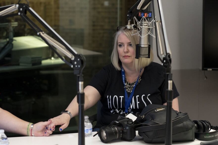 """Erin Gibson gets support from one of her """"widow friends"""" as she shares her story. Gibson says she has suffered from PTSD and depression after her husband's suicide in 2014."""