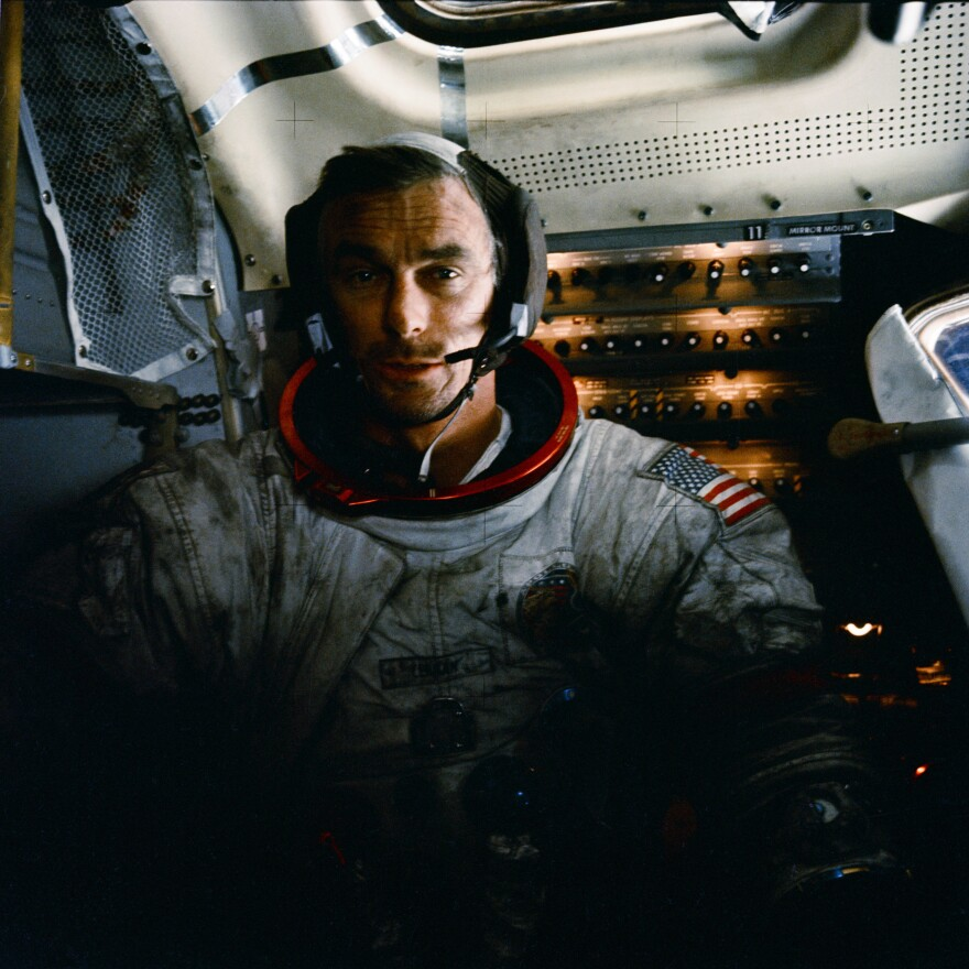 Cernan is photographed inside the lunar module on the lunar surface. Note lunar dust on his suit.