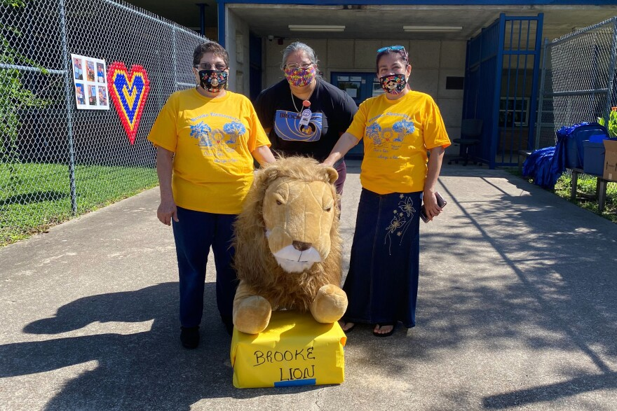Staff from Brooke Elementary pose outside the school on its last day.