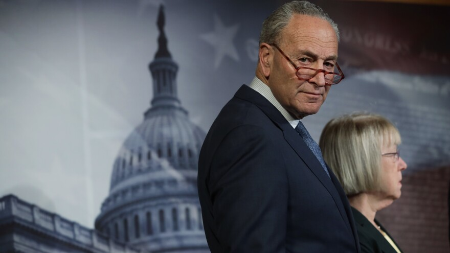 Senate Minority Leader Chuck Schumer listens during a news conference Tuesday.