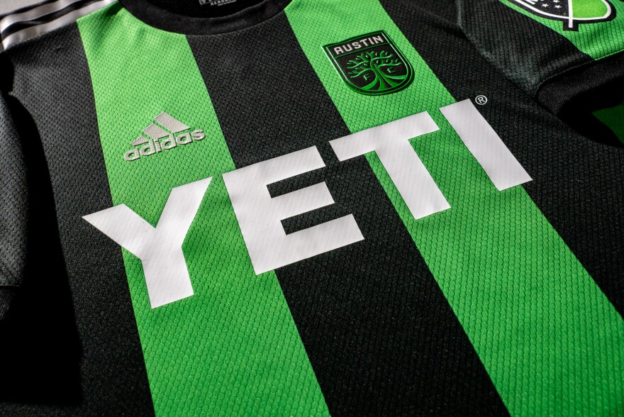 A close-up of the Austin FC's new black and green striped jersey,