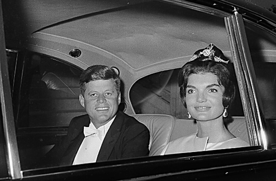 President John F. Kennedy and first lady Jacqueline Kennedy head to a state dinner in the Hall of Mirrors in Versailles, France, in June 1961.