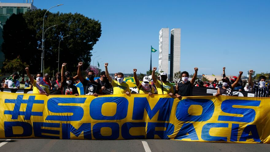 """Demonstrators carry a banner that says, """"We are democracy"""" during a protest against racism last month in Brasilia, Brazil."""