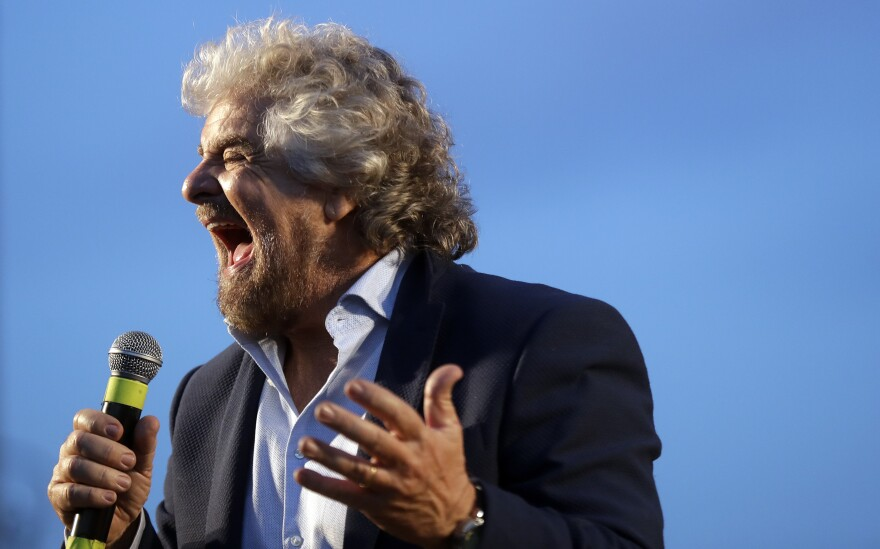 """The leader of Italy's opposition Five-Star Movement, Beppe Grillo, calls for a """"no"""" vote in Sunday's referendum at a Nov. 26 rally."""