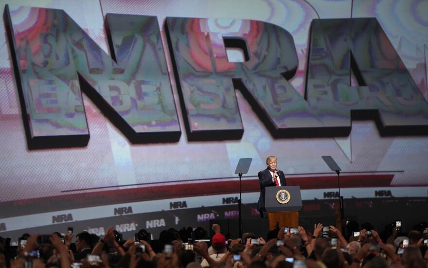 President Trump speaks during the National Rifle Association-ILA Leadership Forum on Friday in Atlanta.
