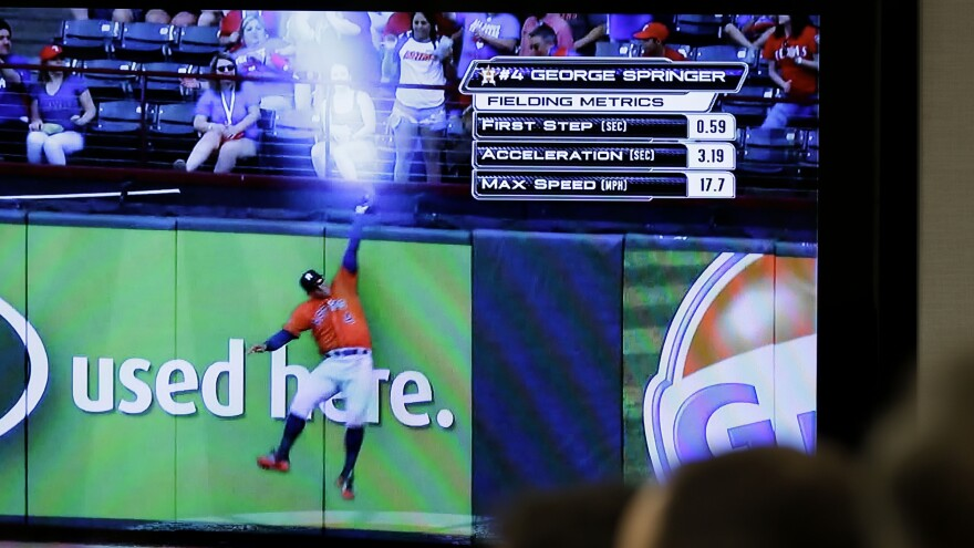 Reporters and Major League Baseball employees watch a demonstration of new statistics made possible by technology upgrades at baseball stadiums during an April 20 news conference in New York.