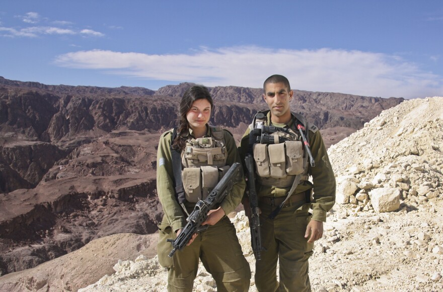 Sgt. Leora Prince (left) said switching to the Caracal battalion and taking on a more hands-on combat position was the best decision she'd ever made. She is shown here with her commanding officer, Capt. Yaron Eyal, near Eilat, along Israel's border with Egypt's Sinai Peninsula.