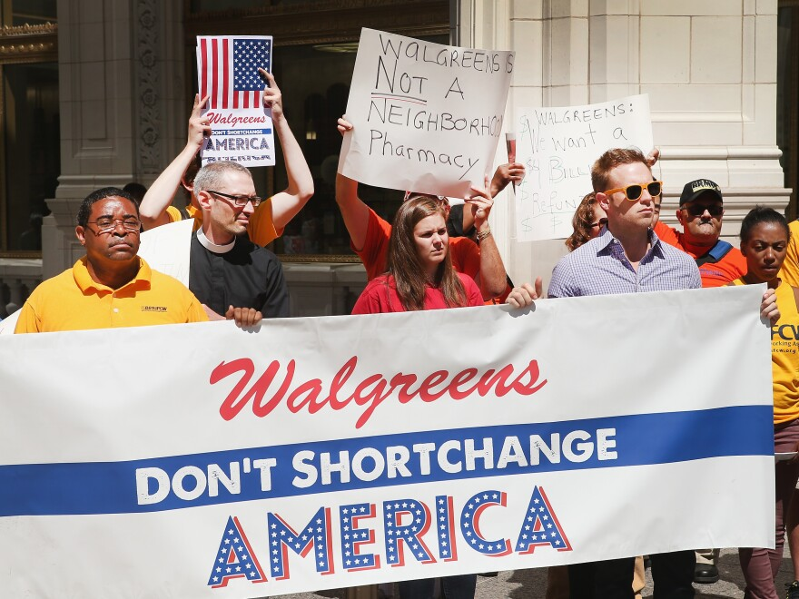 Last month, demonstrators protested the possibility of Walgreens moving its corporate headquarters overseas at a Chicago location of the pharmacy.