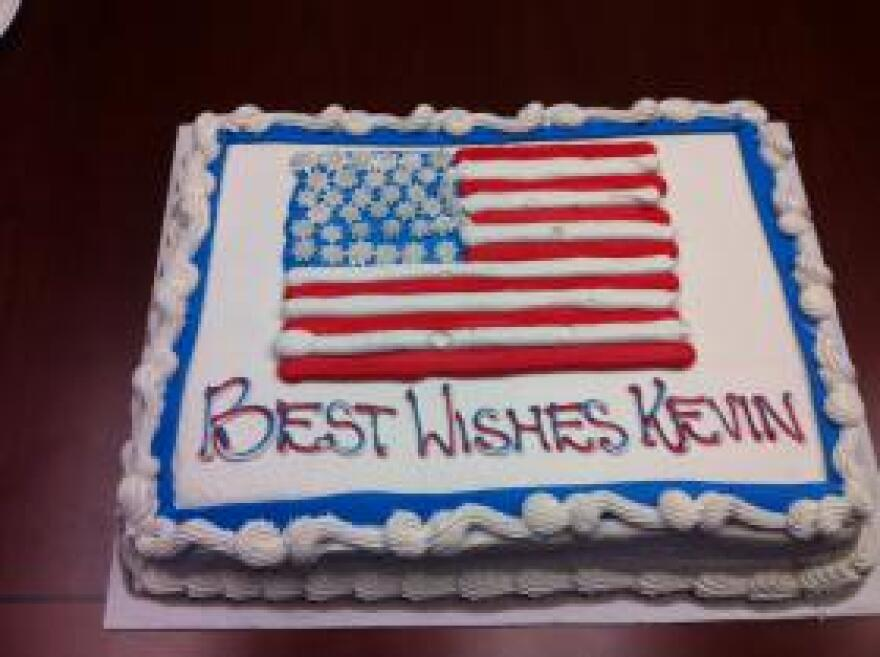 Co-workers presented Kevin Ziober with a cake on his last day in the office before he deployed to Afghanistan.