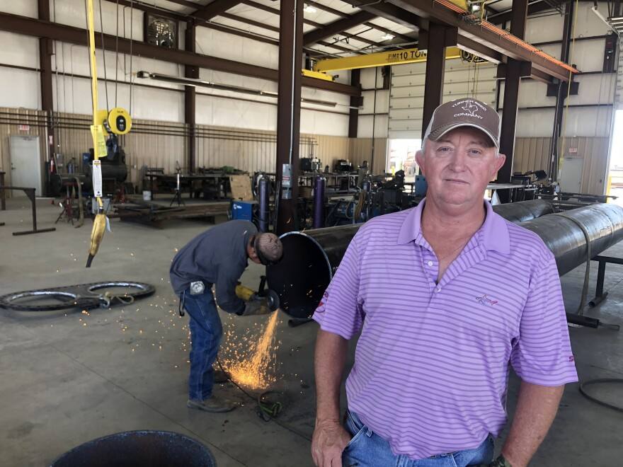 Bob Stewart's machine shop has lost half its business, but he said federal relief money helped him avoid layoffs.