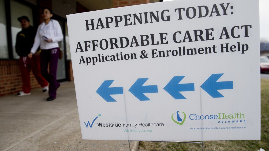 Enrollment help was plentiful for insurance sign-ups in the early years of the Affordable Care Act, such as at this clinic in Bear, Del., in 2014. Though the Trump administration has since slashed the outreach budget, about 930,000 people have signed up for ACA health plans so far this year.