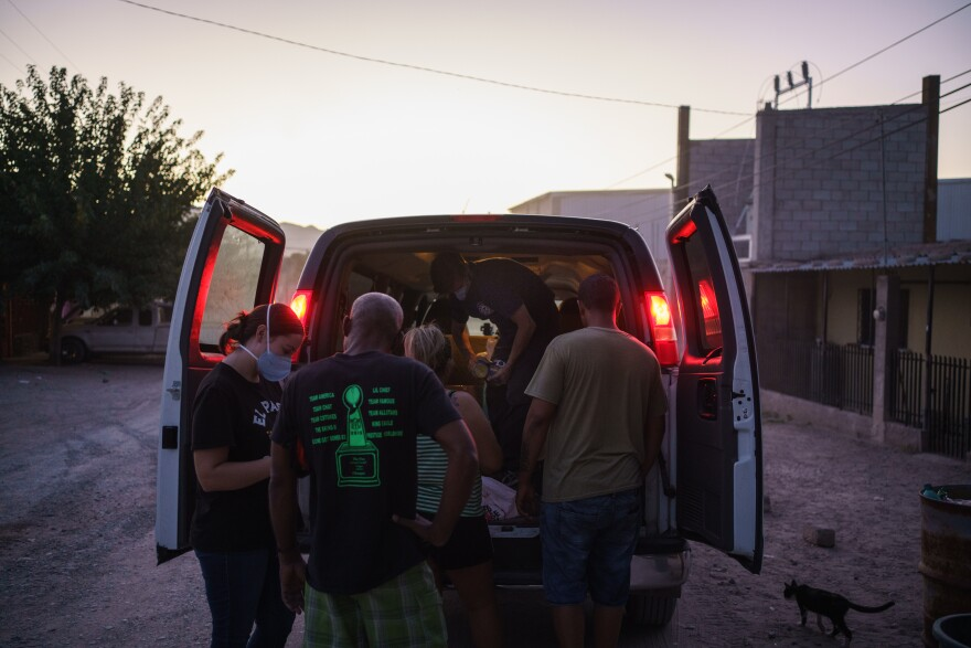 Lindy Morrison and Will Rocci make a food delivery to Cubans in Ciudad Ju‡rez on September 24, 2020 at dusk.