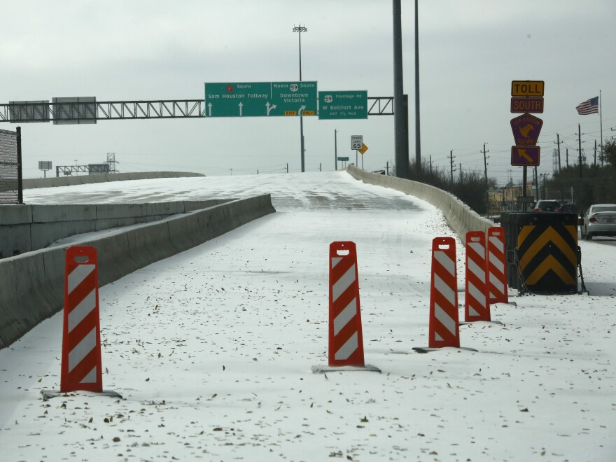 A highway on-ramp in Houston, Texas is closed due to snow and ice on Feb. 15. Frigid temperatures, icy roads and power outages caused by a major winter storm have interfered with COVID-19 vaccine distribution in Texas and several other states.