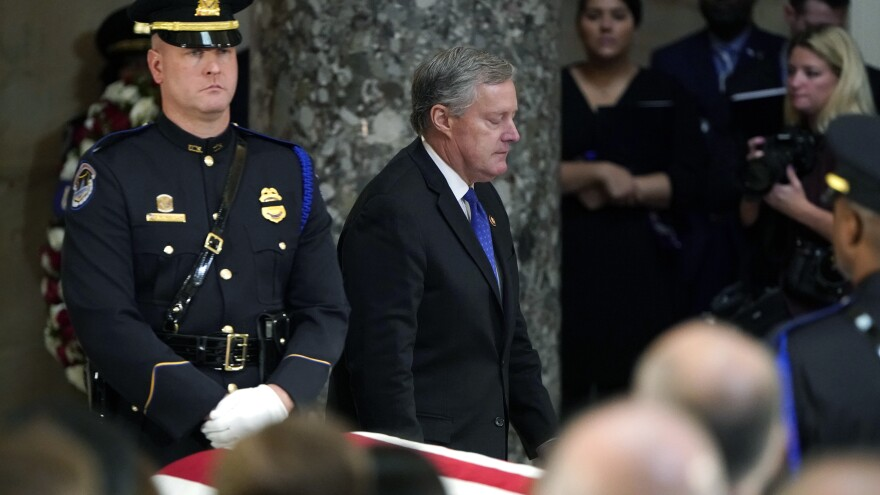 Rep. Mark Meadows closes his eyes as he walks past the casket after speaking during the memorial service for his close friend Rep. Elijah Cummings, D-Md., on Capitol Hill on Thursday.