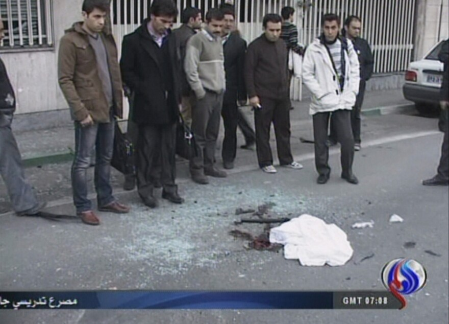 An image grab taken from footage broadcast by Iran's state-run Arabic-language Al-Alam TV shows blood stains covered by a piece of cloth and debris at the site of the car bomb.