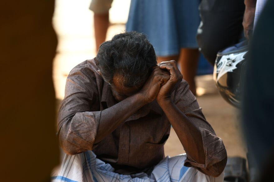 A relative of a Sri Lankan victim of an explosion at a church weeps outside a hospital in Batticaloa in eastern Sri Lanka on Easter.