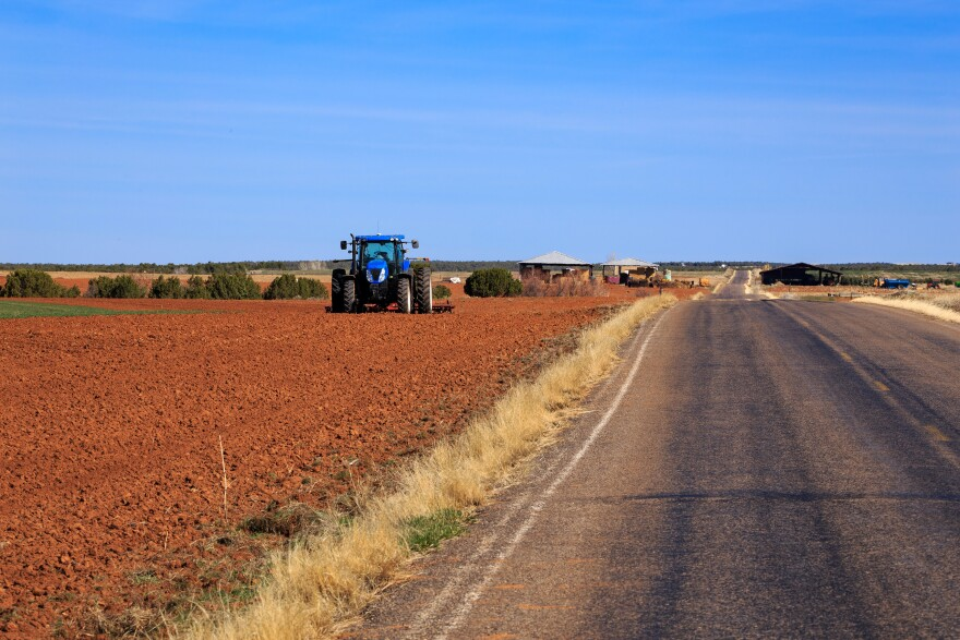 Red dirt farm and tractor.