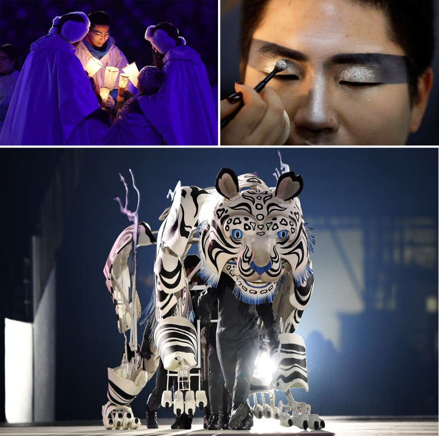 Top: Performers with candles; a makeup artist applies glitter to a performer backstage. Bottom: Dancers perform inside a tiger.