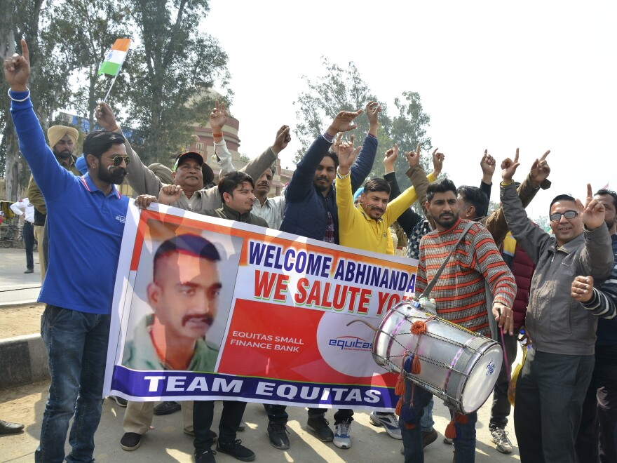 Indians dance as they wait to welcome Indian fighter pilot Abhinandan Varthaman at the Wagah border post with Pakistan, 17.5 miles from Amritsar, India.