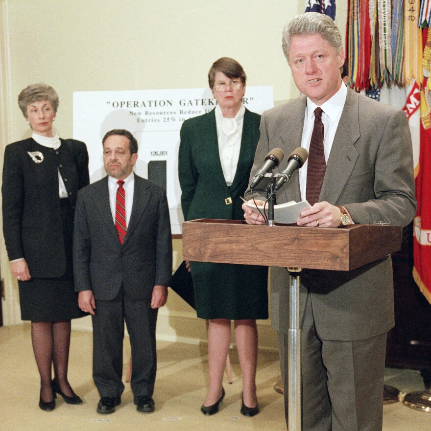 President Bill Clinton unveils his immigration initiative at the White House in 1995, stressing a commitment to fight illegal immigration. He was joined by Immigration and Naturalization Service Commissioner Doris Meissner, Labor Secretary Robert Reich and Attorney General Janet Reno.
