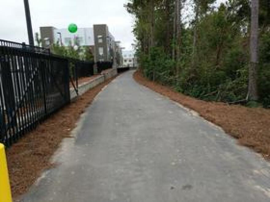 Part of the trail segment runs behind the new Stadium Enclave student apartment complex near the corner of Gaines Street and Lake Bradford Road.
