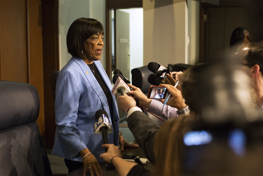 St. Louis County Council member Hazel Erby speaks to reporters after an emergency council meeting Monday night.