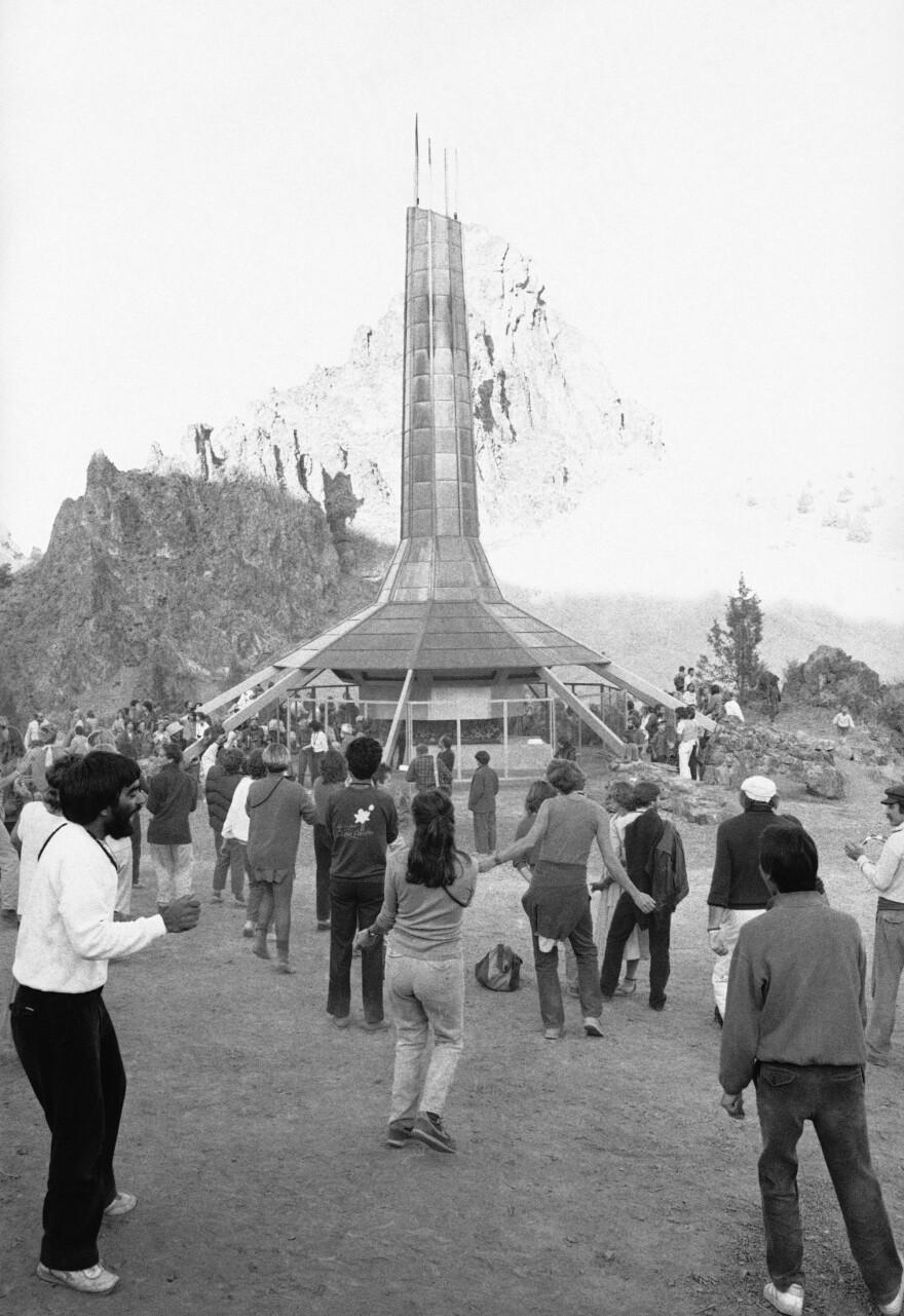Followers of the Bhagwan Shree Rajneesh gather on Oct. 29, 1986 at the crematorium at the Rancho Rajneesh in Rajneeshpuram, Oregon, for a book-burning.