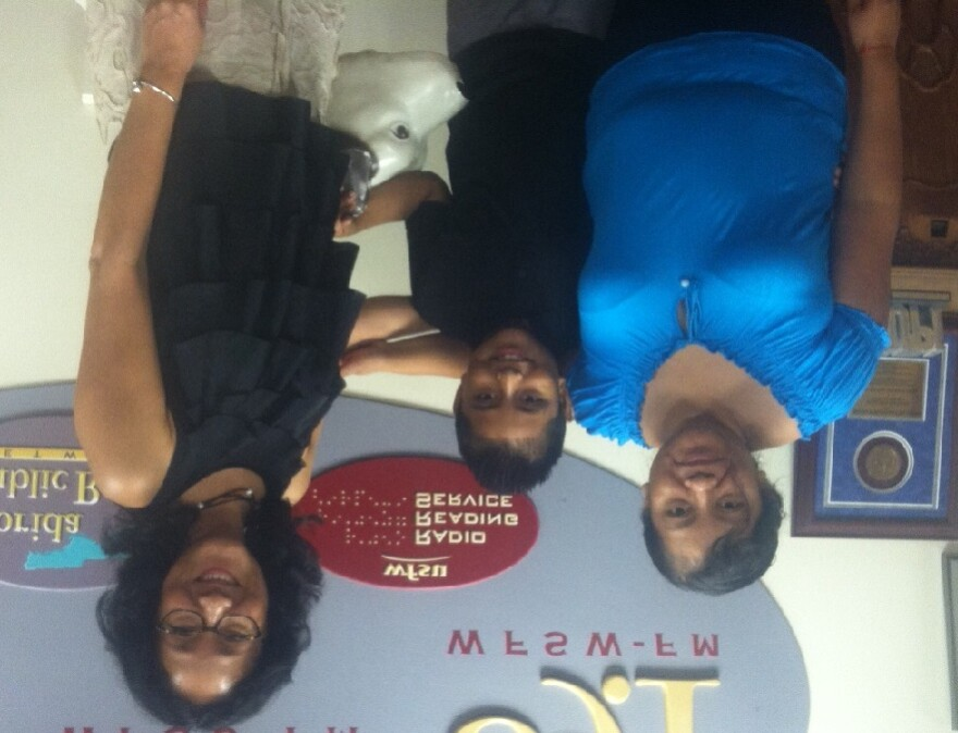 Clara Solano and her son Rey, with Florida State University's Loyda Lopez at the WFSU studios.