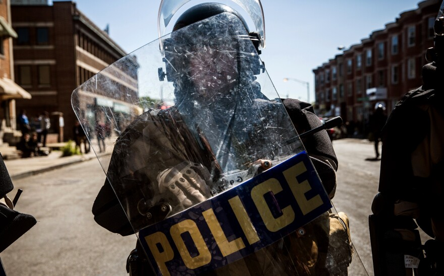 A Maryland state trooper stands guard near a CVS pharmacy that was destroyed during rioting in Baltimore this week.