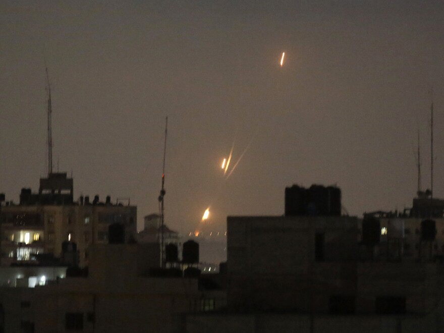 By daybreak Wednesday, images of rockets fired by Palestinian militants, as well as of Israeli strikes, were no longer seen over the Gaza Strip, amid an unofficial Egyptian-brokered cease-fire.
