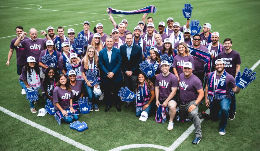 Ally Bank CEO Jeffrey Brown (center left) and Panthers President Tom Glick joined Ally employees in announcing their soccer partnership.