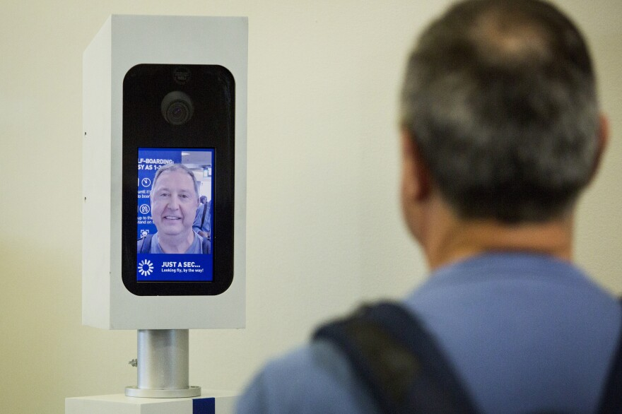 Charles Camiel looks into the camera for a facial recognition test before boarding his JetBlue flight to Aruba at Logan International Airport in Boston.
