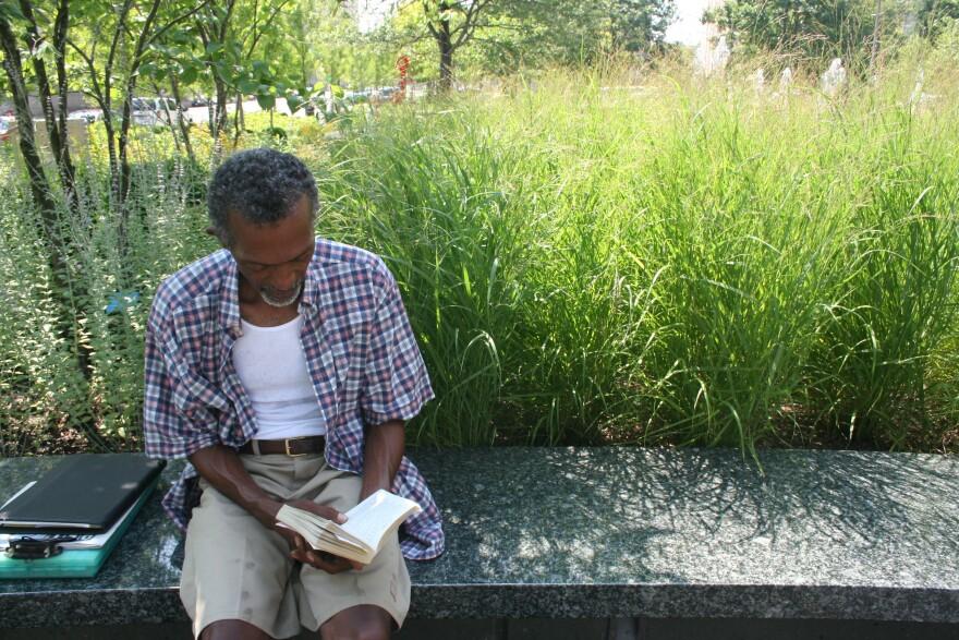 Man reading in Citygarden