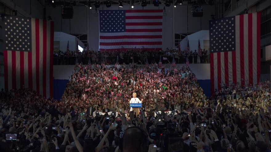 Hillary Clinton addresses her supporters at a rally Tuesday in Brooklyn, N.Y., after clinching her status as presumptive Democratic nominee.