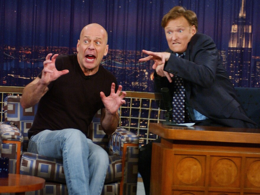 Conan O'Brien interviews Bruce Willis in a 2005 episode of <em>Late Night With Conan O'Brien.</em>