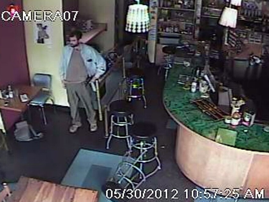 This frame grab from a security camera, released by the Seattle Police Department, shows a man identified by his brother as Ian Stawicki after Wednesday's shooting at Cafe Racer.