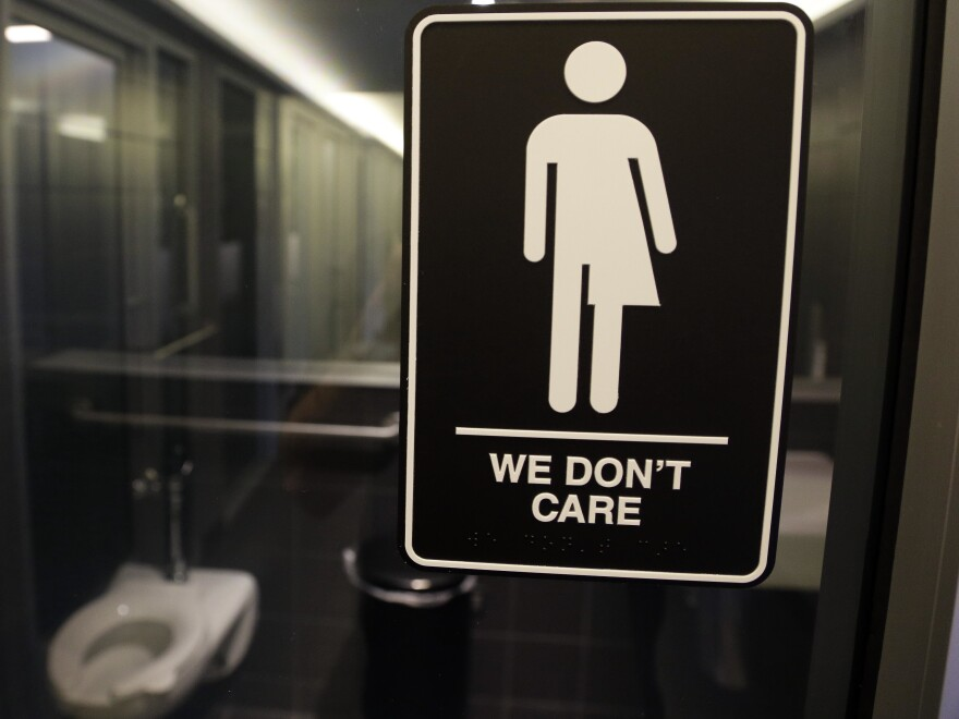 Signage outside a restroom at 21c Museum Hotel in Durham, N.C. A North Carolina law limiting  bathroom choice for transgender people is being challenged in a federal court in Raleigh.
