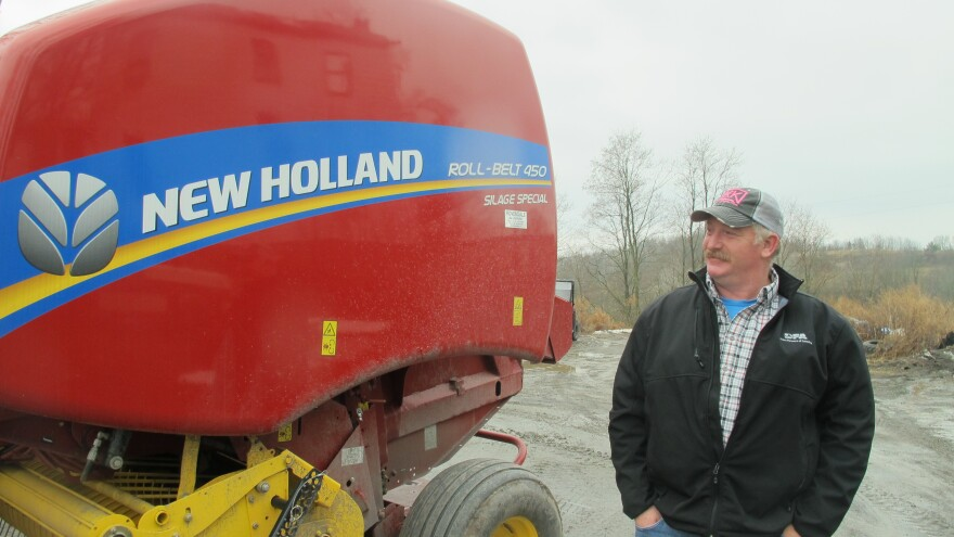 Dairy farmer Charlie Clark bought a new hay baler with the royalties he received from natural gas development on his land.