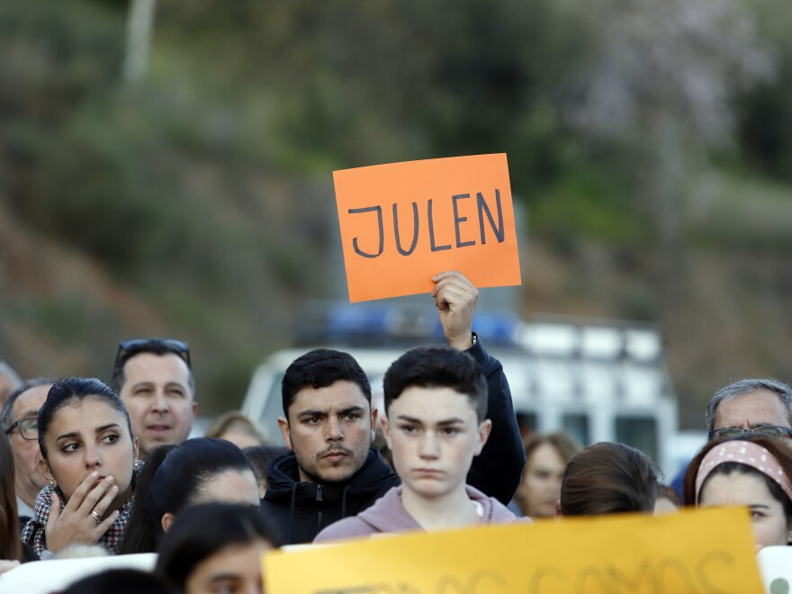 Neighbors gather on Thursday to show their support for the family of toddler Julen Rosello, who fell down a hole Sunday in Spain's Málaga province.