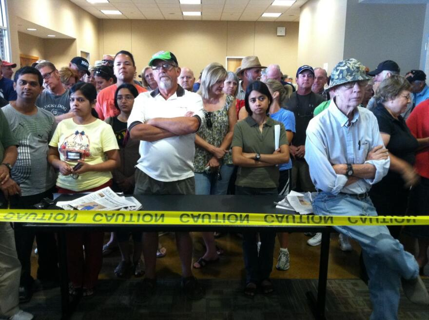 Bastrop County residents await a briefing from fire officials on the morning of September 6, 2011.