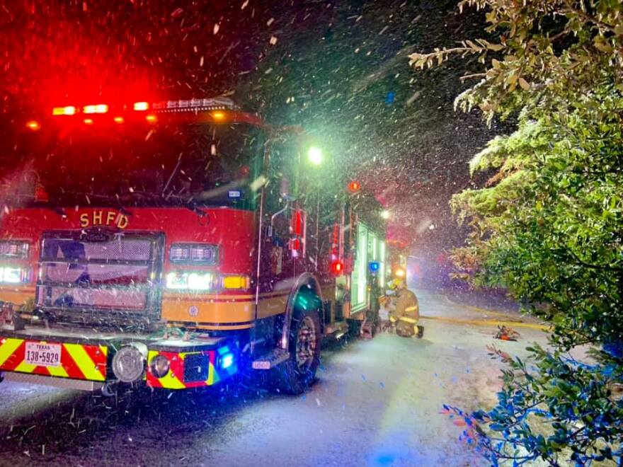 South Hays Fire Department firefighters respond to an emergency during the overnight winter storm.