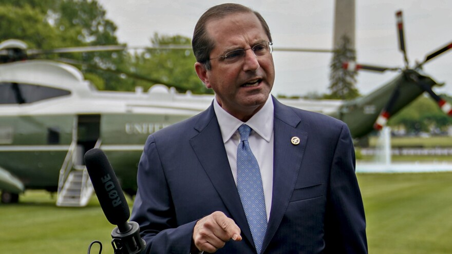 "In an apparent reference to China, Health and Human Services Secretary Alex Azar says a member state of the World Health Organization ""made a mockery of their transparency obligations, with tremendous costs for the entire world."" Azar is seen here last week."