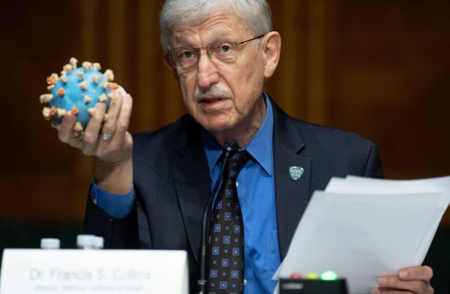 Director of the National Institutes of Health, Dr. Francis Collins, holds a model of the coronavirus. This is the sixth vaccine candidate to join Operation Warp Speed's portfolio, and the largest vaccine deal to date.
