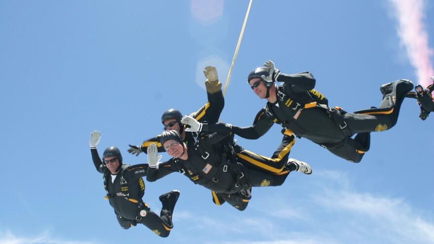 Former U.S. President George H.W. Bush performs a tandem parachute jump on June 13, 2004 over the Bush Presidential Library in College Station, Texas. Bush made the jump to celebrate his 80th birthday.